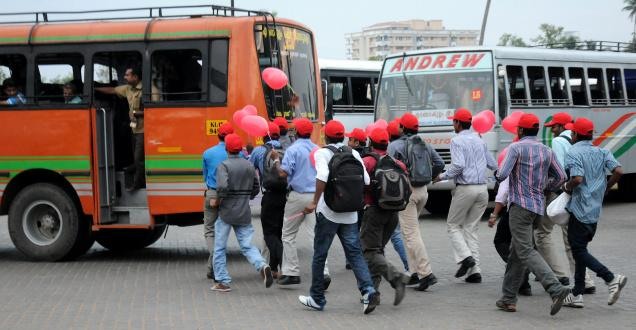 Members of Synergians, an NGO, do a 'nettottam' behind buses at the Vytilla Mobility Hub on Thursday, to highlight inadequate bus services, 'unscientific' arrangements and the problems that commuters face at the hub.