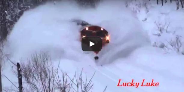 Awesome Powerful Train plow through snow railway tracks