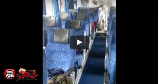 Karnataka RTC conductor arranging seats and curtains before the passengers entering the bus