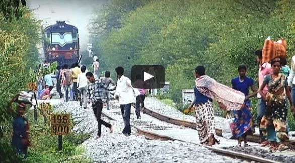 People madly chased by the dancing train